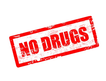 Abstract red rubber stamp with the text no drugs written on it