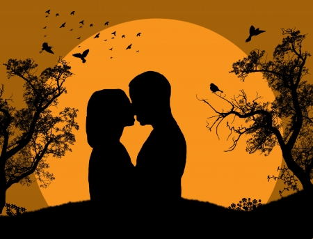 Couple kissing at sunset on the park background