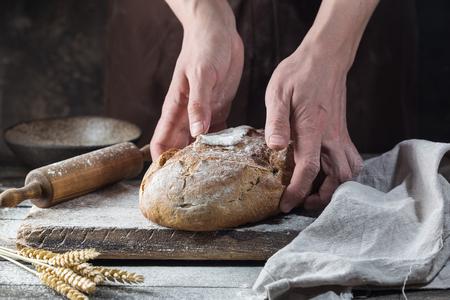 Foto für Baker cooking bread. Man slaps flour over the dough. Man's hands Making bread - Lizenzfreies Bild