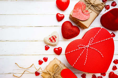 Photo pour Valentines day greeting card with different gift boxes and hearts on white wooden background. - image libre de droit