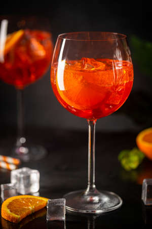 Photo pour cocktail in glass with fresh orange on dark background - image libre de droit