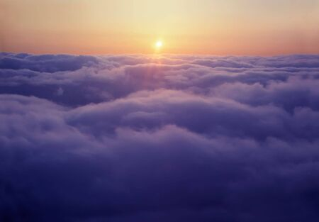 Flying above the clouds, at sunset