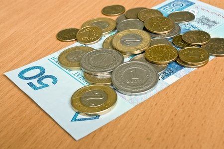polish money - zloty, banknotes and coins on the table