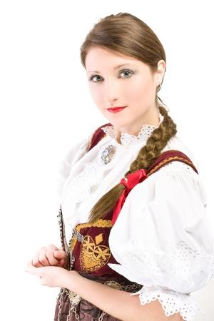 Beauty woman in traditional Polish clothes Cieszyn Silesia region, studio shot on white background