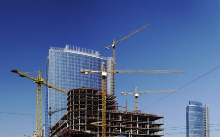 Photo for Construction site with tall cranes on background of modern office buildings - Royalty Free Image