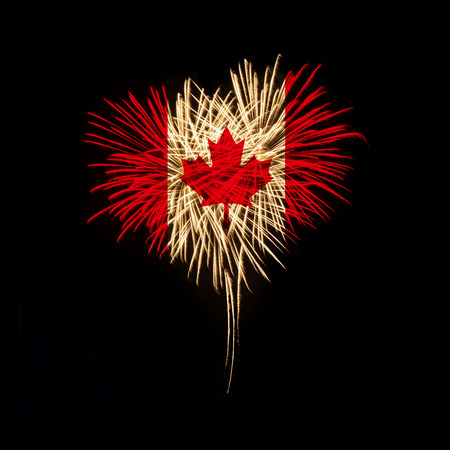 Fireworks in a heart shape with the Canada flag on a black background