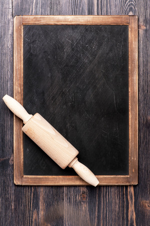 Menu slate chalk board with a rolling pin
