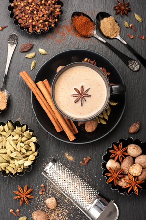 Indian masala chai and spices. Tea with milk and spicy