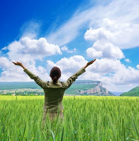 Girl in green meadow.