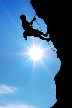 Photo pour Mountain climber on the top.  - image libre de droit