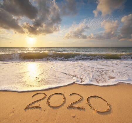 Photo pour 2020 year on the sea shore during sunset. Element of design. - image libre de droit