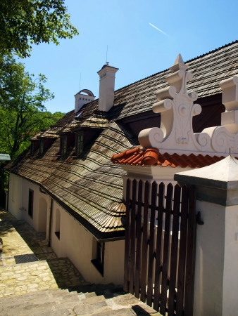 architecturally interesting, with a roof with shingles, a historic building in Kazimierz Dolny on the Vistula River in Poland
