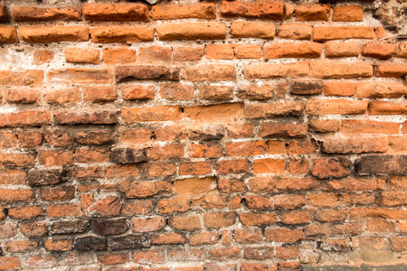 old brick wall with crumbling bricks as a background