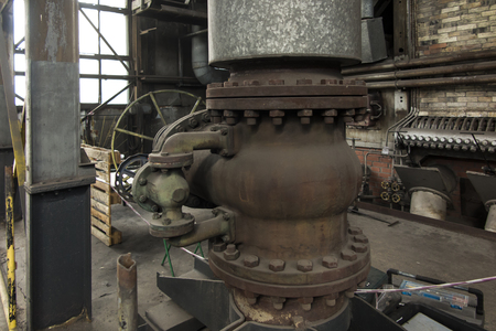 Photo pour An old large gate valve with a relief valve on the hot water pipe - image libre de droit