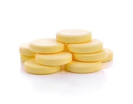 Vitamin C pills on white background