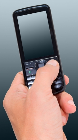 Phone in a man's hand on the gray-green background.