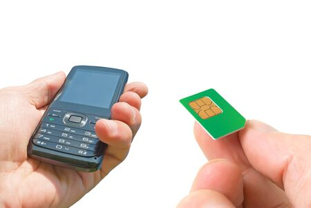 Phone and the SIM card in a man's hands, isolated.