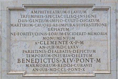 Photo pour Detail of a marble plaque on a wall outside the Colosseum in Rome placed by Pope Benedict XIV pope from 1740 to 1758 dedicated to Christian martyrs - image libre de droit