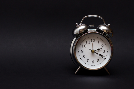 Photo pour vintage alarm clock on black background.For time concept. - image libre de droit
