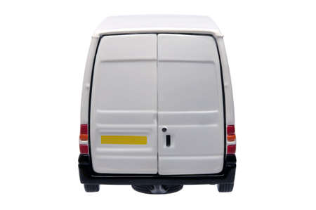 Rear of a model white van with blank door panels for your own branding, isolated on white with clipping path.