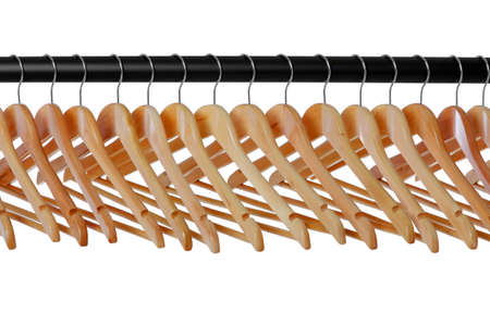 A line of wooden coat hangers on a clothes rail