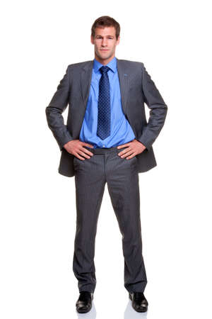 Businessman in a pinstripe suit standing with his hands on his hips, isolated on a white background.