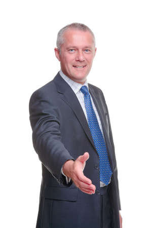 A mature businessman offering to shake your hand, isolated on a white background.の写真素材