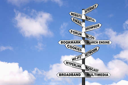 Concept image of a sign with lots of Internet related terminology on the directional arrows, or in other words a signpost on the Information Superhighway.