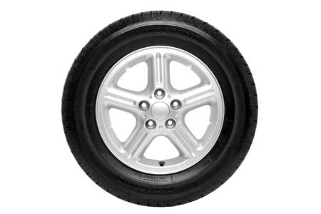 Photo of a car tyre (tire) on a five spoke alloy wheel isolated on a white background