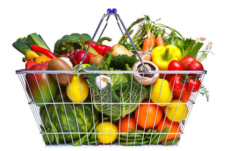 Photo of a wire shopping basket full of fresh fruit and vegetables, isolated on a white background.の写真素材