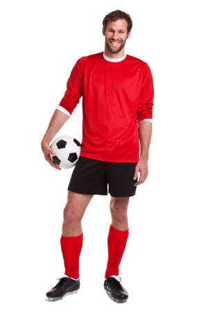 footballer or soccer player cut out on a white background,.