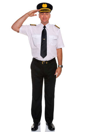 Foto per an airline pilot wearing the four bar Captains epaulettes saluting, isolated on a white background. - Immagine Royalty Free