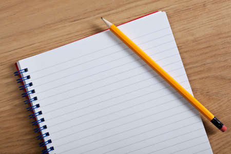 Photo pour Photo of a blank ruled notepad and pencil on a desk, add your own copy. - image libre de droit