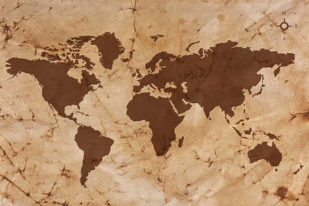 Old World map on creased and stained sepia coloured parchment paper.