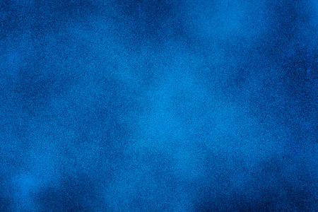 Blue texture background with bright center spotlightの写真素材