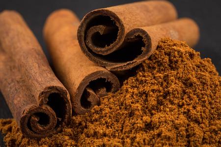 Cinnamon sticks with cinnamon powder