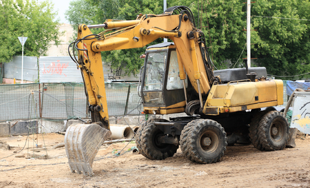 wheeled excavator on ground at day
