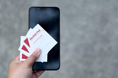 Photo pour Alcohol pad for clean phone and technology to prevent corona virus covid-19 - image libre de droit