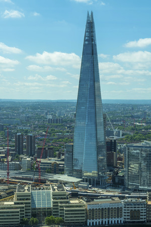 LONDON, UK - JULY 4, 2015: View of Shard form The Sky Garden, Europe's highest garden space located on top of Walkie Talkie office building at 20 Fenchurch Street