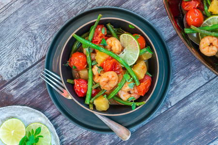 Photo pour Thai prawns with pineapple and green beans - top view - image libre de droit