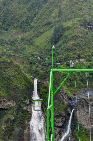 zipline adventure against Manto de la Novia waterfall in Banos de Agua Santa, Tungurahua, Ecuador