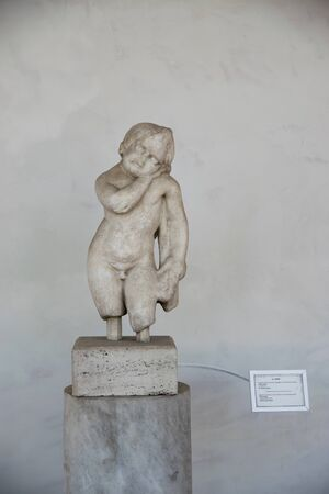 Ancient sculpture of Cupid in the baths of Diocletian (Thermae Diocletiani) in Rome. Italy