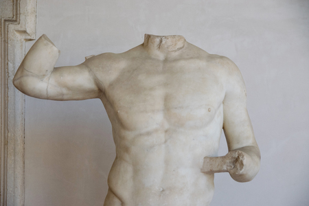 Ancient sculpture of the man in the baths of Diocletian (Thermae Diocletiani) in Rome. Italy