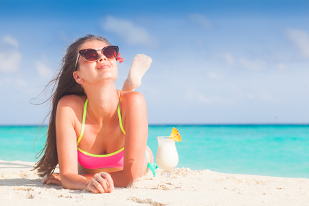 Photo pour pretty longhaired woman with delicious pina colada cocktail by the beach. Maldives - image libre de droit
