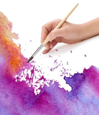 Photo pour hand with brush and watercolor paint - image libre de droit