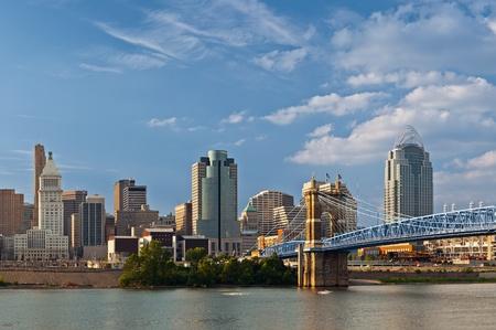 Photo for Cincinnati skyline. Image of Cincinnati skyline and historic John A. Roebling suspension bridge cross Ohio River. - Royalty Free Image