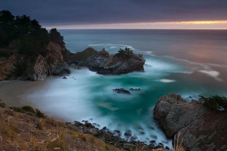 Pacific coastline. McWay Falls at Julia Pfeiffer Burns State Park Big Sur California.