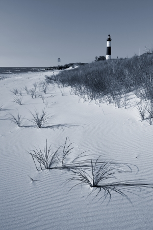 Big Sable Point Lighthouse. Image of the Big Sable Point Lighthouse and sandy beach at Lake Michigan.