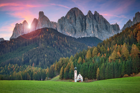 Dolomites. The little church of S.Giovanni in Ranui, located in Funes Valley, Southern Tyrol, Italy.
