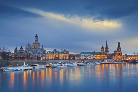 Dresden. Image of Dresden, Germany during twilight blue hour with Elbe River in the foreground.